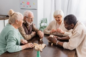 Seniors playing games to combat senior loneliness