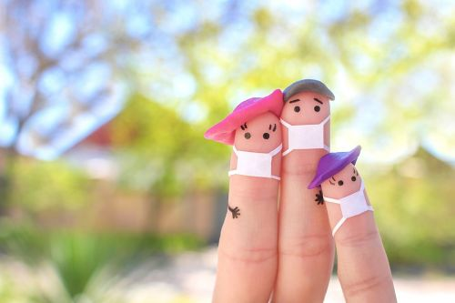 Fingers art of family with face mask on walk. Estate Planning. Covid.