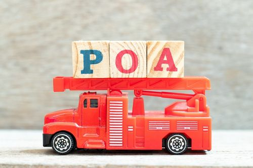 Block letters on toy fire truck showing POA for Power of Attorney