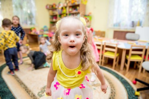 special needs planning portrayed by young girl with down sundrom